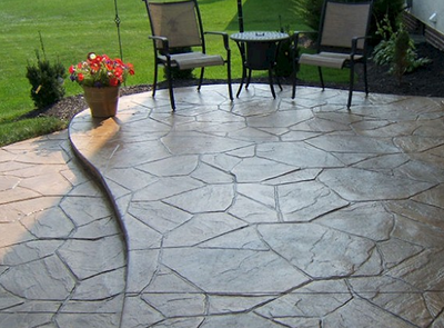 Multi-shaped sand stone style stamped concrete patio.