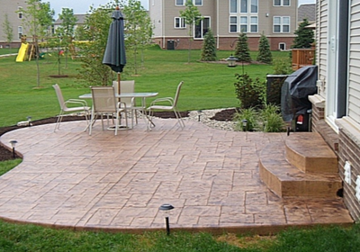 Stone shaped stamped concrete patio.