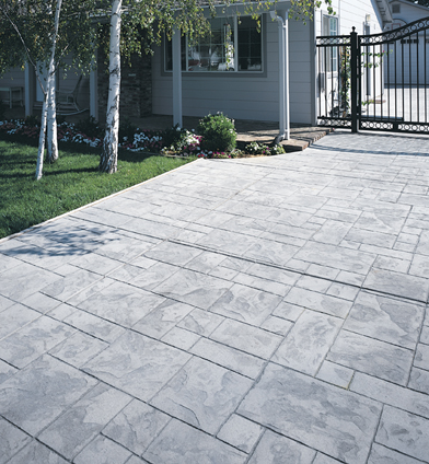 Gray stone shaped concrete patio.