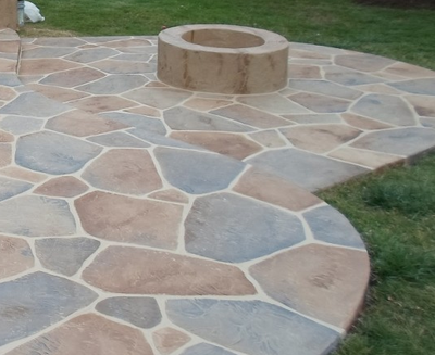 Multi-colored grays and browns sand stone shaped  decorative concrete patio.