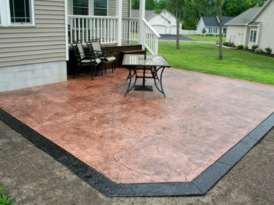 Simple textured concrete patio, with a dark brown stamped edge