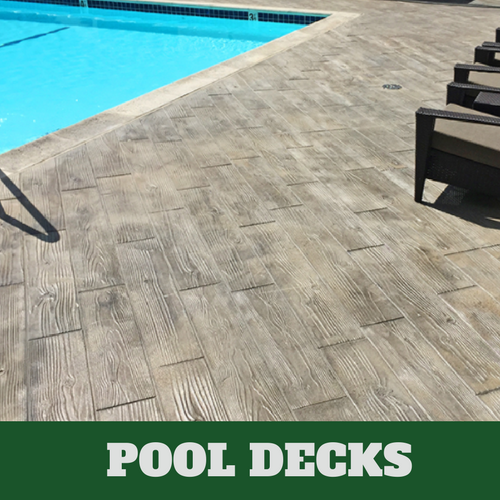 Grand Rapids stamped concrete pool surround with a wood grain finish.