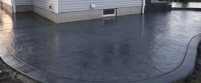 Dark gray stained and polished concrete.