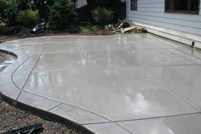 Polished concrete with a stamped concrete edging.