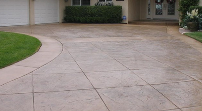 Large tile shaped stamps for a wide angle driveway.